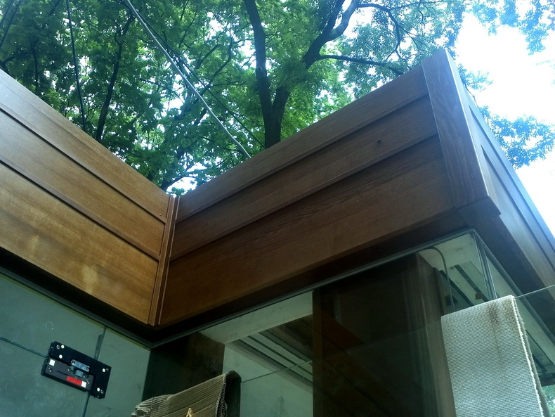 Монтаж деревянной обшивки по фасаду